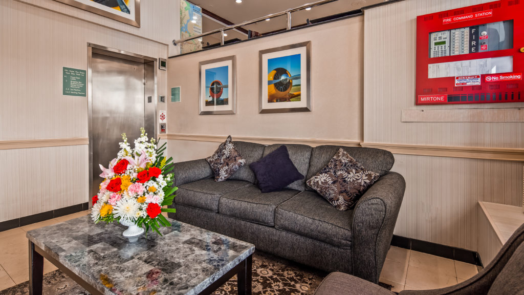 Best Western JFK Airport Hotel lobby seating with elevator