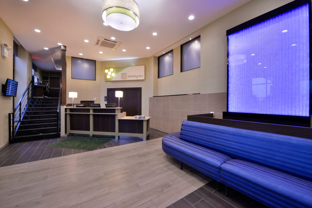 Holiday Inn New York JFK Airport Area front desk and lobby seating