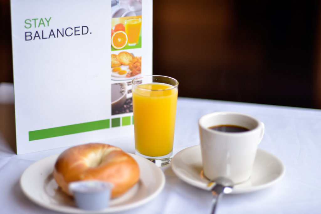 Holiday Inn New York JFK Airport Area menu, bagel, orange juice, and coffee