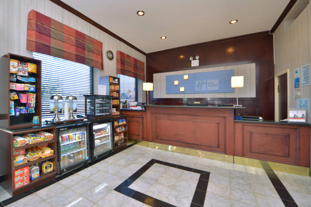 Holiday Inn Express New York JFK Airport Area front desk and convenience store