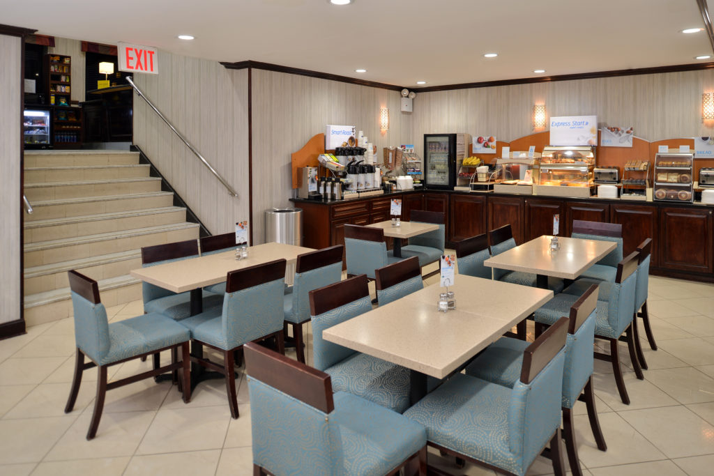 Holiday Inn Express New York JFK Airport Area Express Start breakfast bar with seating