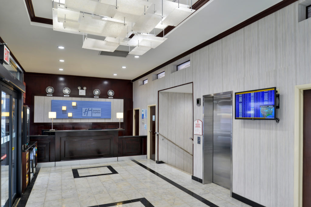Holiday Inn Express New York JFK Airport Area front desk and elevator