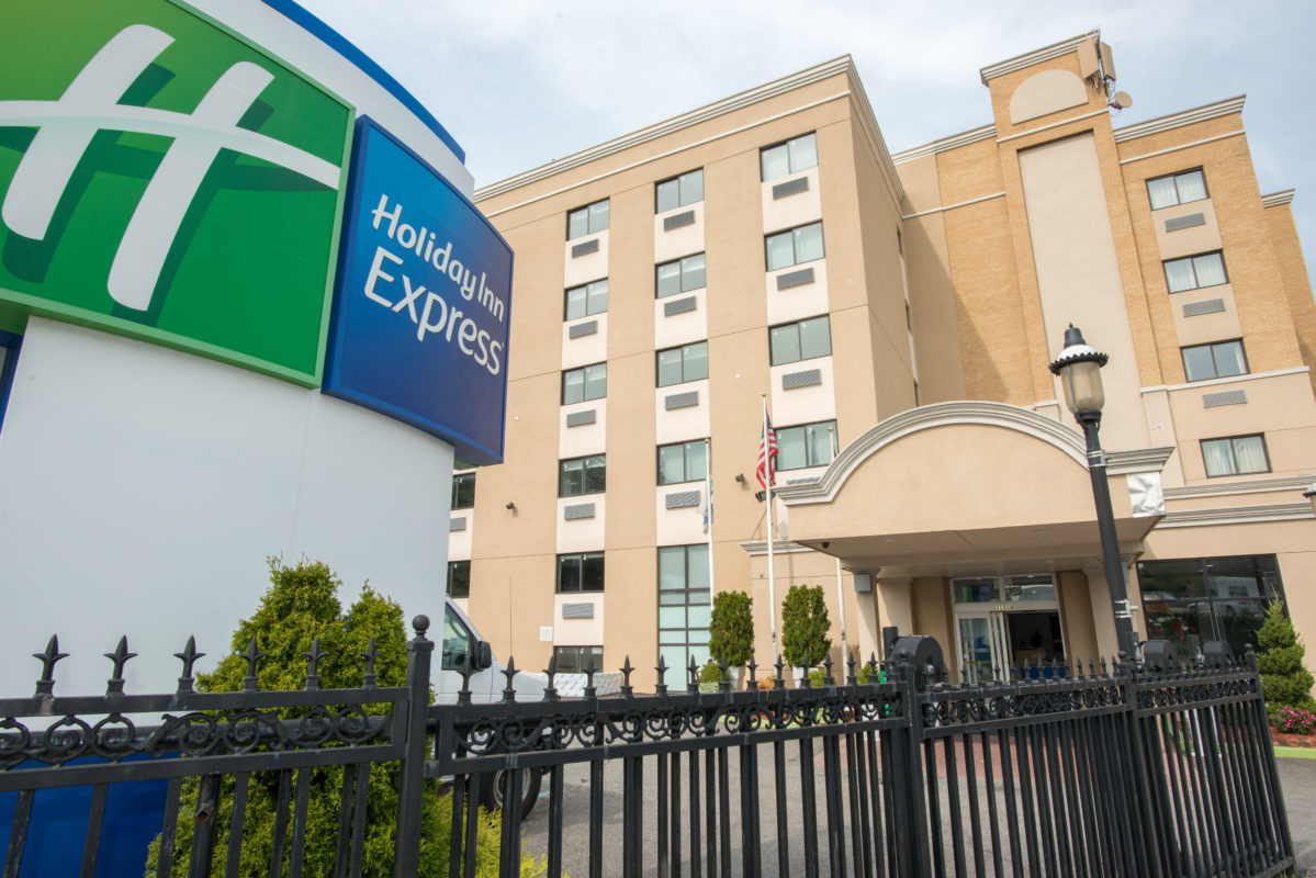 Holiday Inn Express LaGuardia Airport exterior and sign