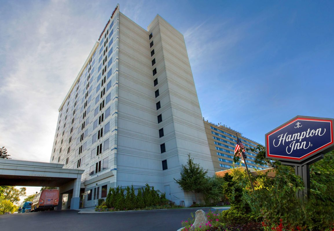 Hampton Inn NY-JFK Exterior with sign daytime