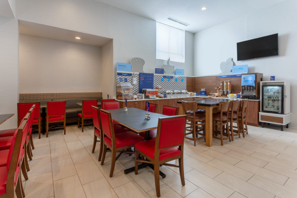 Holiday Inn Express LaGuardia Airport breakfast bar with seating