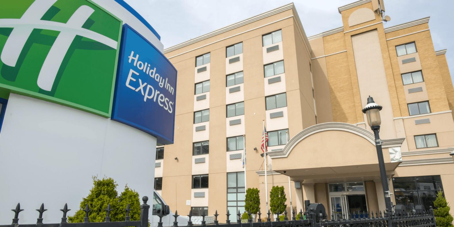 Holiday Inn Express LaGuardia Airport exterior and sign