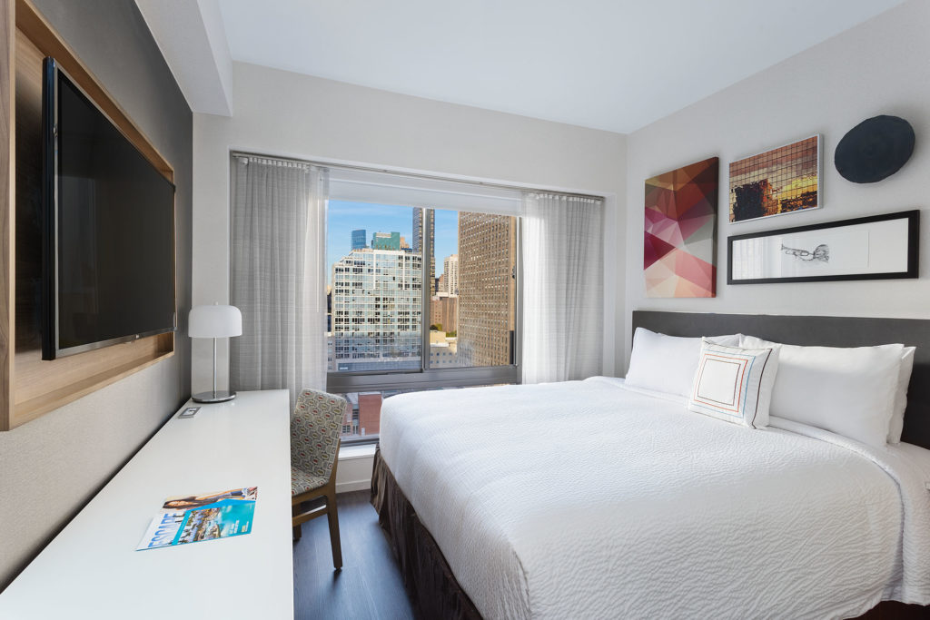 Fairfield Inn & Suites New York Manhattan/Central Park king guest room with a daytime view