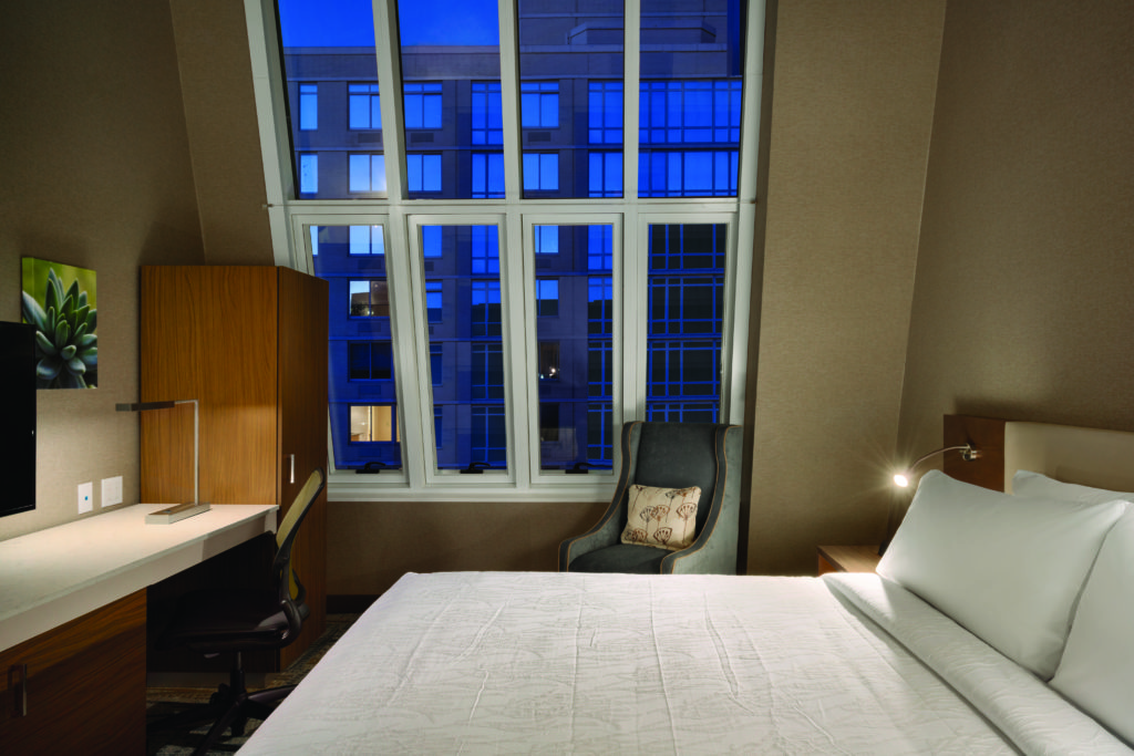 Hilton Garden Inn New York Times Square South king bed sky view guest room