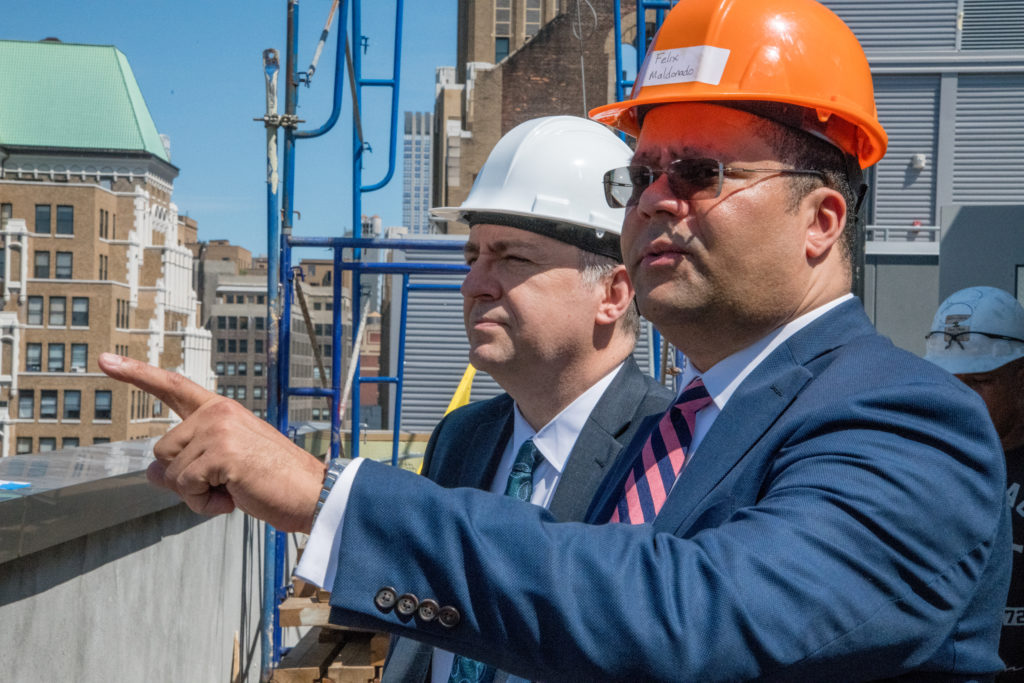 Executives inspect a hotel construction site